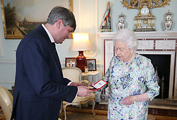 RETRANSMITTED FOR THOSE NEEDING Queen Elizabeth II presents Simon Armitage with The Queen's Gold Medal for Poetry upon his appointment as Poet Laureate during an audience at Buckingham Palace, London.