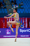 Vladinova Neviana during the qualication of ribbon at the Pesaro World Cup 2018. Neviana come from Bulgaria. She is born in Pleven in 1994. Her dream is to win a medal at the 2020 Olympic Games in Tokyo.