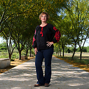 National Butterfly Center Director Marianna TreviÒo-Wright under Retama trees at the center on Wednesday, April 11, 2018, in Mission, Texas. <br /> Photo by Nathan Lambrecht