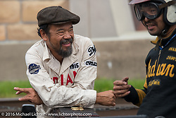 Shinya Kimura of Japan having fun with teammate and co-rider Yoshimasa Niimi of Japan after crossing the finish line in Cape Girardeau during the Motorcycle Cannonball Race of the Century. Stage-5 from Bloomington, IN to Cape Girardeau, MO. USA. Wednesday September 14, 2016. Photography ©2016 Michael Lichter.