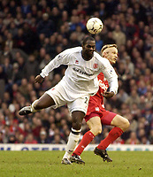 Photo. Jed Wee<br />Liverpool v Middlesbrough, FA Barclaycard Premiership, Anfield, Liverpool. 08/02/2003.<br />Middlesbrough's new signing Michael Ricketts (L) gets to the ball ahead of Liverpool's Sami Hyypia.