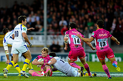 Exeter Chiefs Inside Centre (#12) Jason Shoemark is tackled by Clermont Prop (#1) Thomas Domingo during the first half of the match - Photo mandatory by-line: Rogan Thomson/JMP - Tel: Mobile: 07966 386802 20/10/2012 - SPORT - RUGBY - Sandy Park Stadium - Exeter. Exeter Chiefs v ASM Clermont Auvergne - Heineken Cup Round 2