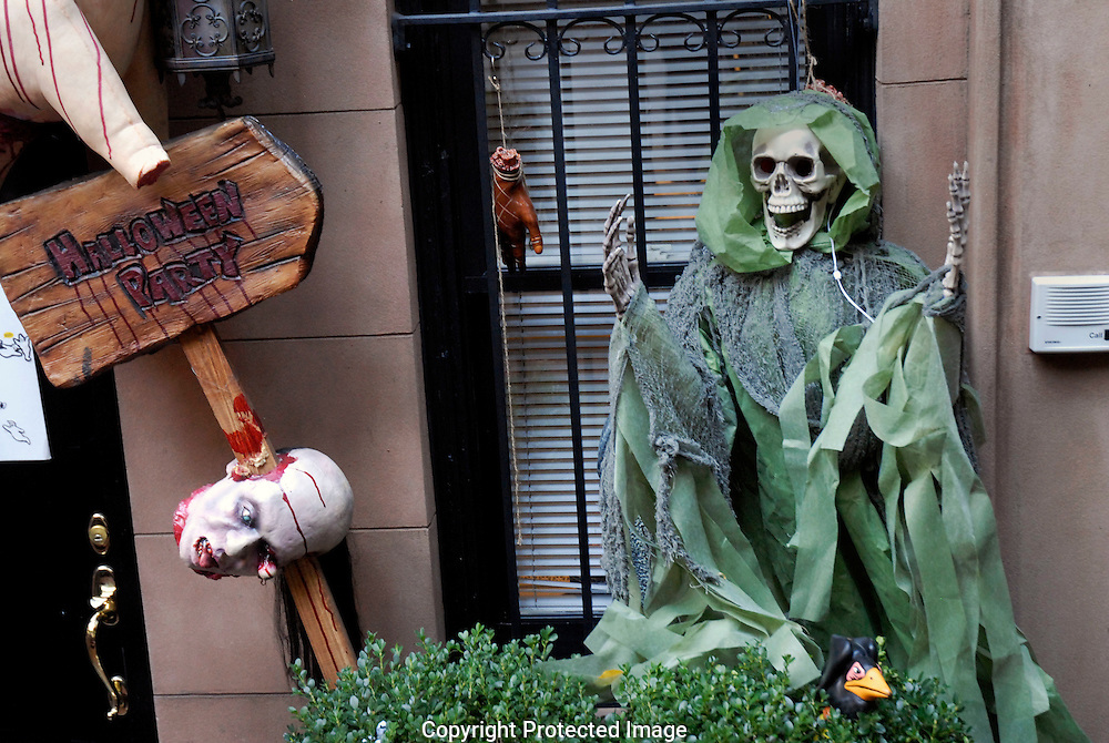 Halloween display  of skeletons on outside of house in New York City