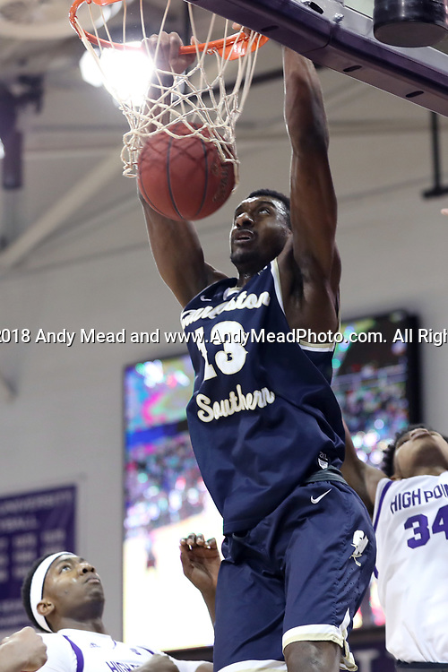 HIGH POINT, NC - JANUARY 06: Charleston Southern's Jordan Jones dunks the ball. The High Point University of Panthers hosted the Charleston Southern University Buccaneers on January 6, 2018 at Millis Athletic Convocation Center in High Point, NC in a Division I men's college basketball game. HPU won the game 80-59.