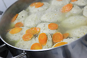Cooking Gefilte Fish, A traditional Askenazi Jewish festive dish of poached fish patties made from a mixture of ground deboned carp, traditionally eaten on the Jewish Rosh Hashana Feast and Passover Seder
