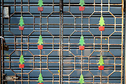 Christmas tree design on a metal gate on the streets of Yangon on 16th May 2016 in Myanmar.