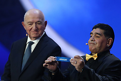 December 1, 2017 - Moscow, Russia - Draw assistant, Diego Maradona (R) draws Uruguay during the Final Draw for the 2018 FIFA World Cup Russia at the State Kremlin Palace on December 1, 2017 in Moscow, Russia. (Credit Image: © Igor Russak/NurPhoto via ZUMA Press)