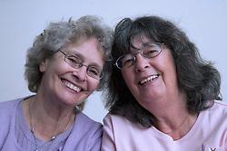 Two older women talking together,