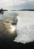 View from Governor's Island bridge shows signs of the ice receding on Lake Winnipesaukee Tuesday morning.  (Karen Bobotas/for the Laconia Daily Sun)