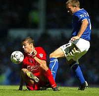 Photo Aidan Ellis.<br />Everton v Liverpool.<br />FA Barclaycard Premiership.<br />30/08/2003.<br />Liverpool's Milan Baros and Everton's Alan Stubbs