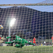 ANDORRA LA VELLA, ANDORRA. June 1.  Florian Thauvin #20 of France scores his sides third goal beating keeper Josep Gomes #1 of Andorra during the Andorra V France 2020 European Championship Qualifying, Group H match at the Estadi Nacional d'Andorra on June 11th 2019 in Andorra (Photo by Tim Clayton/Corbis via Getty Images)