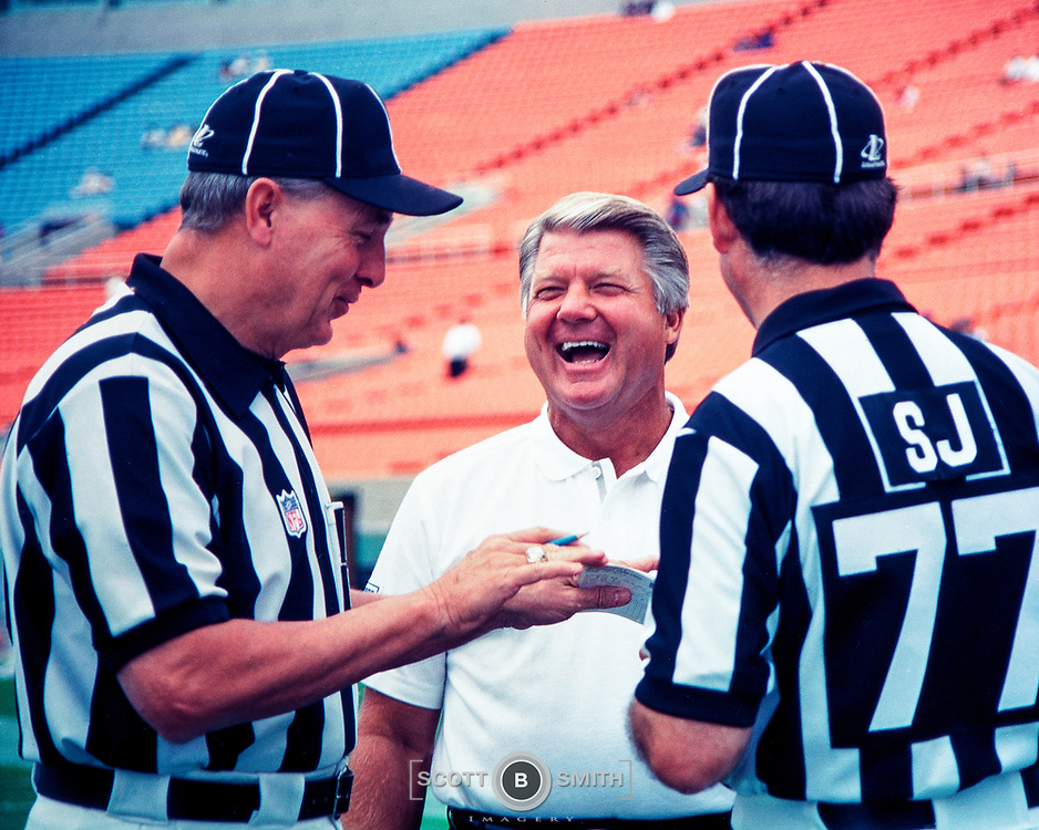 Photographer Al Messerschmidt captures Miami Dolphins coach Jimmy Johnson talks with game officials before a game with the Chicago Bears, 1996.
