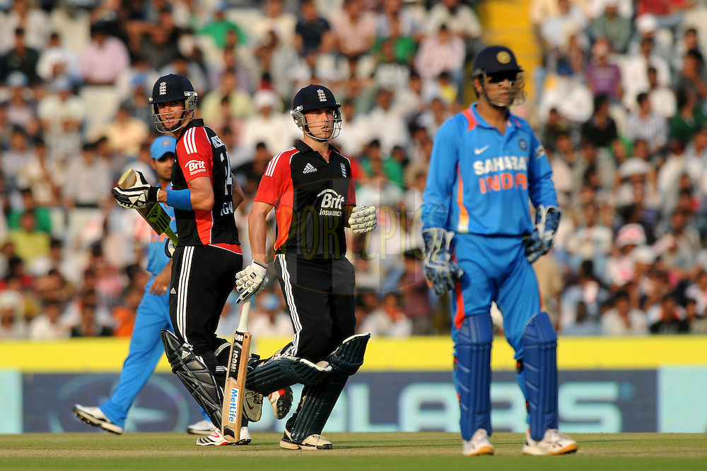 Kevin Pietersen of England and J Trott  bats during the 3rd One Day International ( ODI ) match between India and England held at  the PCA Stadium, Mohali on the 20th October 2011..Photo by Pal Pillai/BCCI/SPORTZPICS