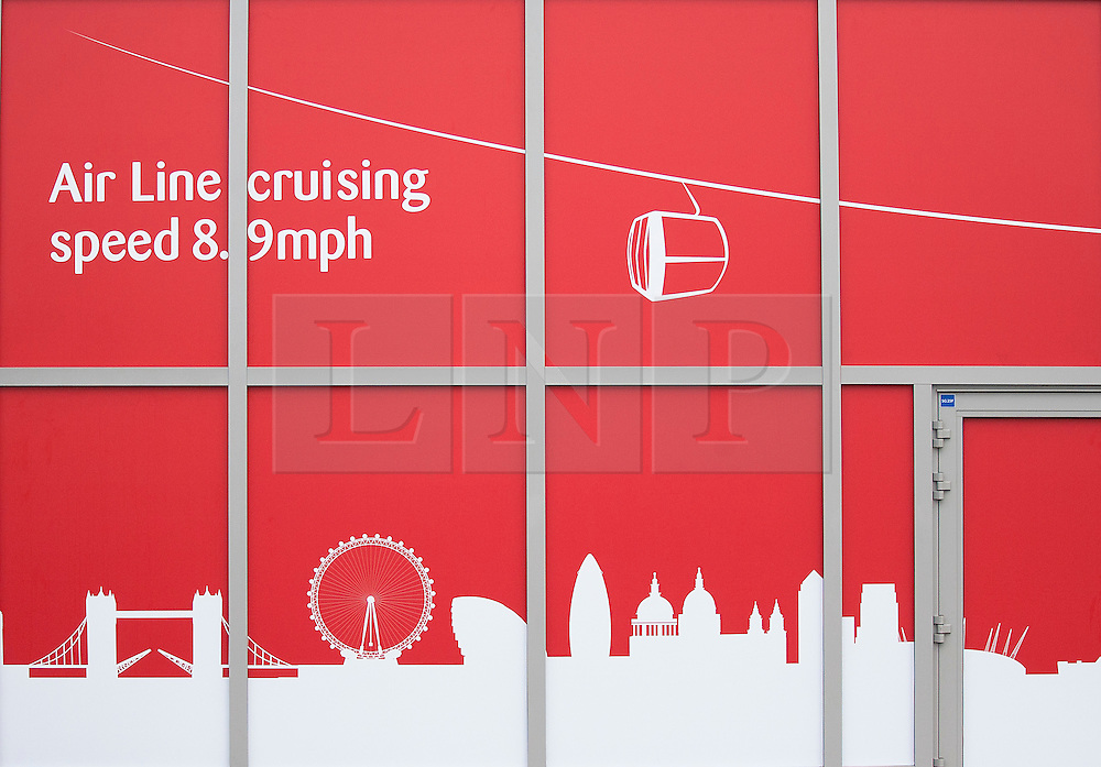 © Licensed to London News Pictures. 28/06/2012. LONDON, UK. A sign for the Greenwich Peninsula Emirates Air-Line terminal is seen in East London today (28/06/12) at the launch of London's first cable car system. The new cable car system, running across the River Thames between the Greenwich Peninsula and the Royal Docks in East London, was today opened to the public, despite fears that it would not be ready in time for the London 2012 Olympics. Photo credit: Matt Cetti-Roberts/LNP