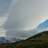 Wind-driven lenticular clouds hover above  The Towers of Paine & Monte Almirante Nieto in Torres del Paine National Park in Patagonia, Chile.
