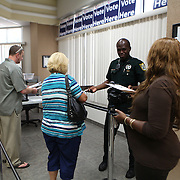 Residents fill out lotto forms to witness George Zimmerman's trial in the shooting death of Trayvon Martin at the Seminole County Criminal Justice Center on  Monday, June 24, 2013 in Sanford, Florida. A lottery system is in place for members of the public to sign their names and deposit them into a box, at the Seminole County Supervisor of Elections office. Twenty fours seats to the courtroom proceedings are drawn randomly, every day before trial proceeds the next day. (AP Photo/Alex Menendez)