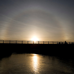 Halo around the sun over the Connecticut River in Gilman, Vermont and Cushman, New Hampshire.