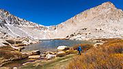 Hiker exploring the Cottonwood Lakes Basin at Lake #4, John Muir Wilderness, California USA