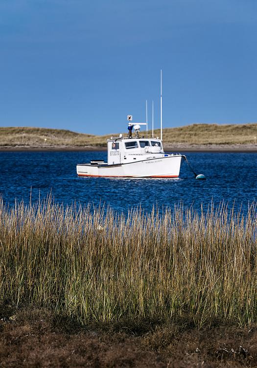 Lobster boat in Nauset Harbor, Orleans, Cape Cod, Massachusetts, USA