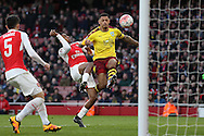 Andre Gray of Burnley is challenged by Alex Iwobi of Arsenal. The Emirates FA cup, 4th round match, Arsenal v Burnley at the Emirates Stadium in London on Saturday 30th January 2016.<br /> pic by John Patrick Fletcher, Andrew Orchard sports photography.
