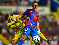 VALENCIA, SPAIN - AUGUST 24:  Jordi Xumetra (R) of Levante UD is tackled by Denis Cheryshev of Villarreal CF during the la Liga match between Levante UD and Villarreal CF at Ciutat de Valencia on August 24, 2014 in Valencia, Spain.  (Photo by Manuel Queimadelos Alonso/Getty Images)