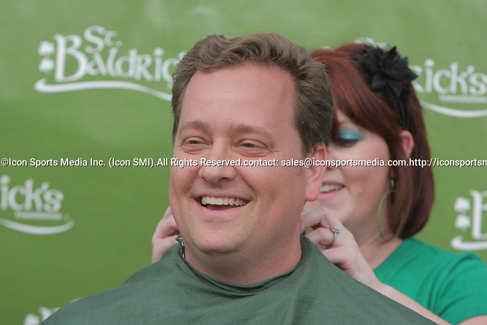 12 March 2009: Sean Mickal gets his head shaved by Courtney Diaz of Salon Stefano during the annual St. Baldrick's children's cancer charity fund raiser held at Parasol's Bar in the Irish Channel of New Orleans, Louisiana.