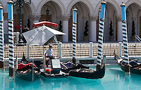Gondolas at the Venetian hotel in Las Vegas Nevada. A replica canal allows visitors to travel along in gondolas recreating the experience of venice