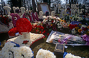 Floral tributes at the graveside of notorious gangland brother Ronnie Kray, on 29th March 1995, in Bethnal Green, East London, England.