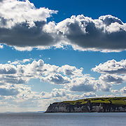 Dramatic clouds and sunshine over Beer Head.