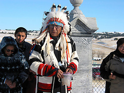 Chief Arvol Looking Horse addresses the mourners after the Big Foot Ride, commemorating the Massacre at Wounded Knee. Wounded Knee Memorial Site, SD.