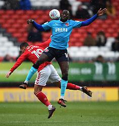 Charlton Athletic's Jake Forster-Caskey (left) battle for the ball Fleetwood Town's Toumani Diagouraga