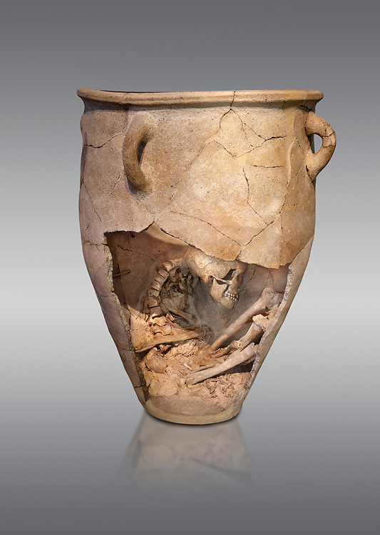 The Minoan clay burial pithos with skeleton in foetal,  Neopalatial period 1700-1450 BC; Heraklion Archaeological  Museum, grey background.<br /> <br /> The body was placed in a foetal postion to aid insertion into the wide mouthed pithos .<br /> <br /> If you prefer to buy from our ALAMY PHOTO LIBRARY  Collection visit : https://www.alamy.com/portfolio/paul-williams-funkystock/minoan-art-artefacts.html . Type -   Heraklion   - into the LOWER SEARCH WITHIN GALLERY box. Refine search by adding background colour, place, museum etc<br /> <br /> Visit our MINOAN ART PHOTO COLLECTIONS for more photos to download  as wall art prints https://funkystock.photoshelter.com/gallery-collection/Ancient-Minoans-Art-Artefacts-Antiquities-Historic-Places-Pictures-Images-of/C0000ricT2SU_M9w