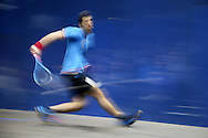 Omar Mosaad of Egypt (wearing light Blue shirt) hits a shot against Mathieu Castagnet of France during the Final, Omar Mosaad of Egypt v Mathieu Castagnet of France , Canary Wharf Squash Classic 2016 , at the East Wintergarden in Canary Wharf , London on Friday 11th March 2016.<br /> pic by John Patrick Fletcher, Andrew Orchard sports photography.