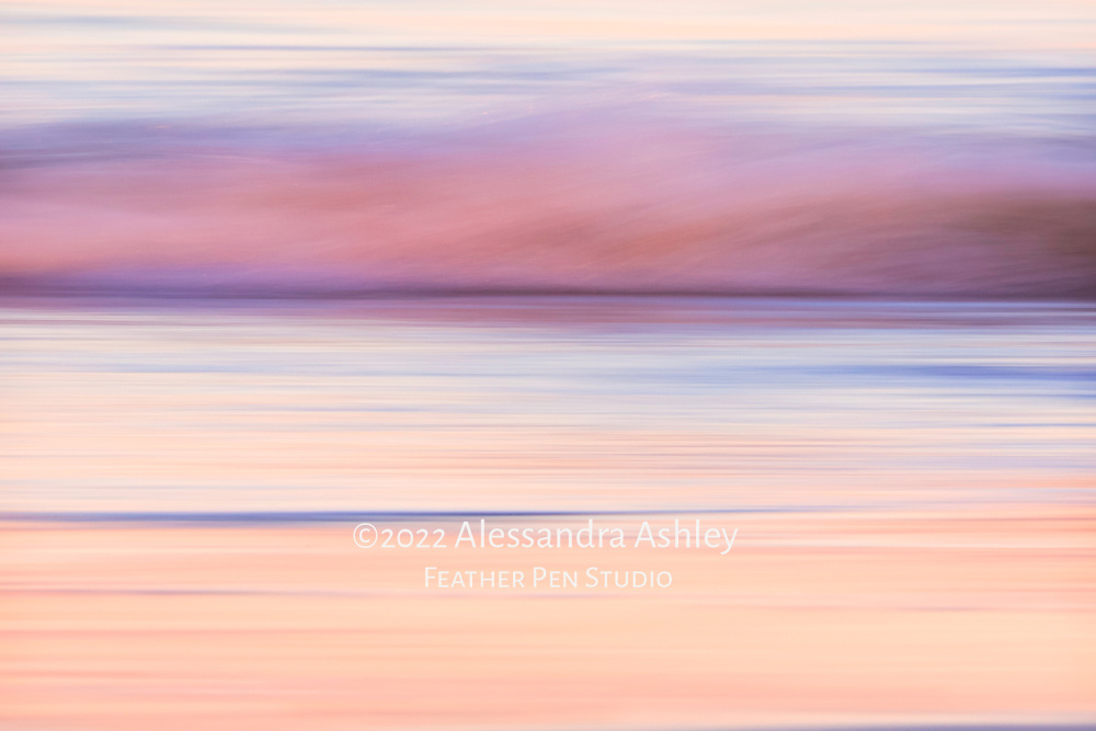 Long exposure pan blur, in-camera effect, waves of Gulf of Mexico at first light, warm tones.