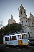 Lisbon's nº28 yellow tram arriving at Basílica da Estrela, on his way through the central, most historic region of the city.
