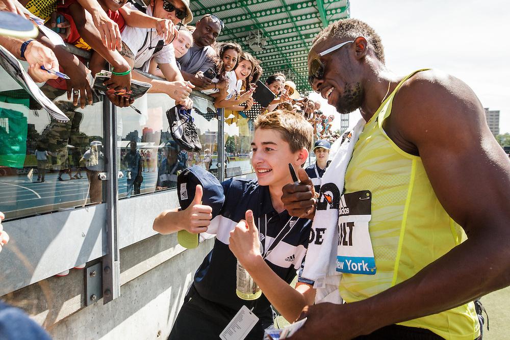 adidas Grand Prix Diamond League Track & Field: Usain Bolt greets fans after winning 200m