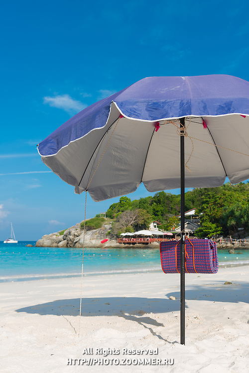 Beach umbrella, or parasol in Raya island, Thailand