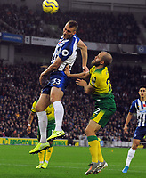 Football - 2019 / 2020 Premier League - Brighton & Hove Albion vs. Norwich City<br /> <br /> Teemu Pukki of Norwich is out jumped by Dan Burn, at The Amex.<br /> <br /> COLORSPORT/ANDREW COWIE
