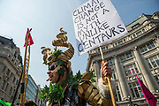 A woman dressed as a centaur shouts and laughs during a protest against climate change in the middle of Oxford Circus on 15th April, 2019 in London, United Kingdom.  Extinction Rebellion have blocked five central London landmarks in protest against government inaction on climate change. .