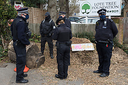 Sipson, UK. 8th March, 2021. Bailiffs from the National Eviction Team (NET), facilitated by the Metropolitan Police, evict residents from the remaining section of a squatted off-grid eco-community garden known as Grow Heathrow. Grow Heathrow was founded in 2010 on a previously derelict site close to Heathrow airport in protest against government plans for a third runway and has since made a significant educational and spiritual contribution to life in the Heathrow villages which are threatened by airport expansion.