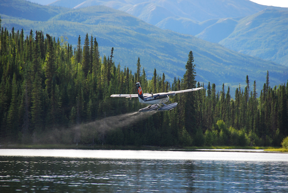 Float plane taking off from Haywire Lake in the Northwest Territories of Canada.