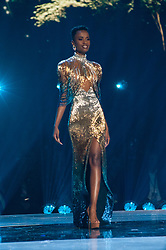 December 8, Atlanta, Georgia, USA: Zozibini Tunzi, Miss South Africa 2019 competes on stage in an evening gown of her choice as a Top 10 finalist during The Miss Universe Competitionlive from Tyler Perry Studios in Atlanta. Contestants from around the globe have spent the last few weeks touring, filming, rehearsing and preparing to compete for the Miss Universe crown. (Credit Image: ? Miss Universe Organization/ZUMA Wire/ZUMAPRESS.com)