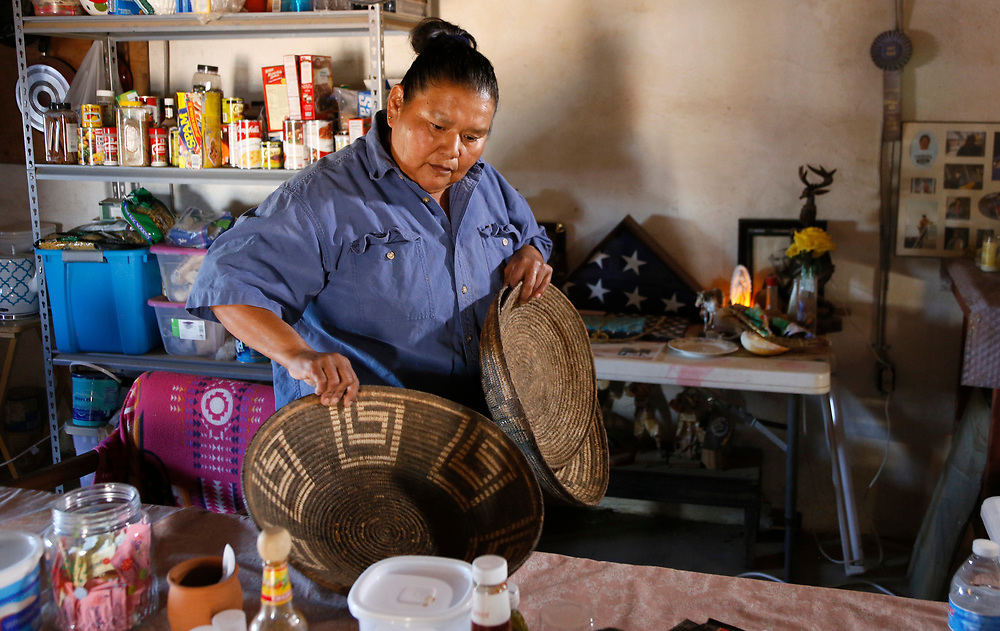 Francine Jose looks at baskets made by her ancestors over 100 years ago on her family ranch near the U.S.- Mexico border on the Tohono O'odham reservation in Chukut Kuk, Arizona April 6, 2017. Picture taken April 6, 2017.  REUTERS/Rick Wilking