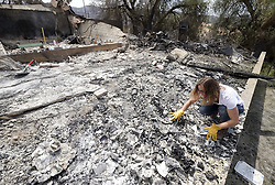 September 4, 2017 - Los Angeles, California, U.S - A woman surveys the charred debris left in a burned out home in the Sunland-Tujunga of Los Angeles. (Credit Image: © Ringo Chiu via ZUMA Wire)