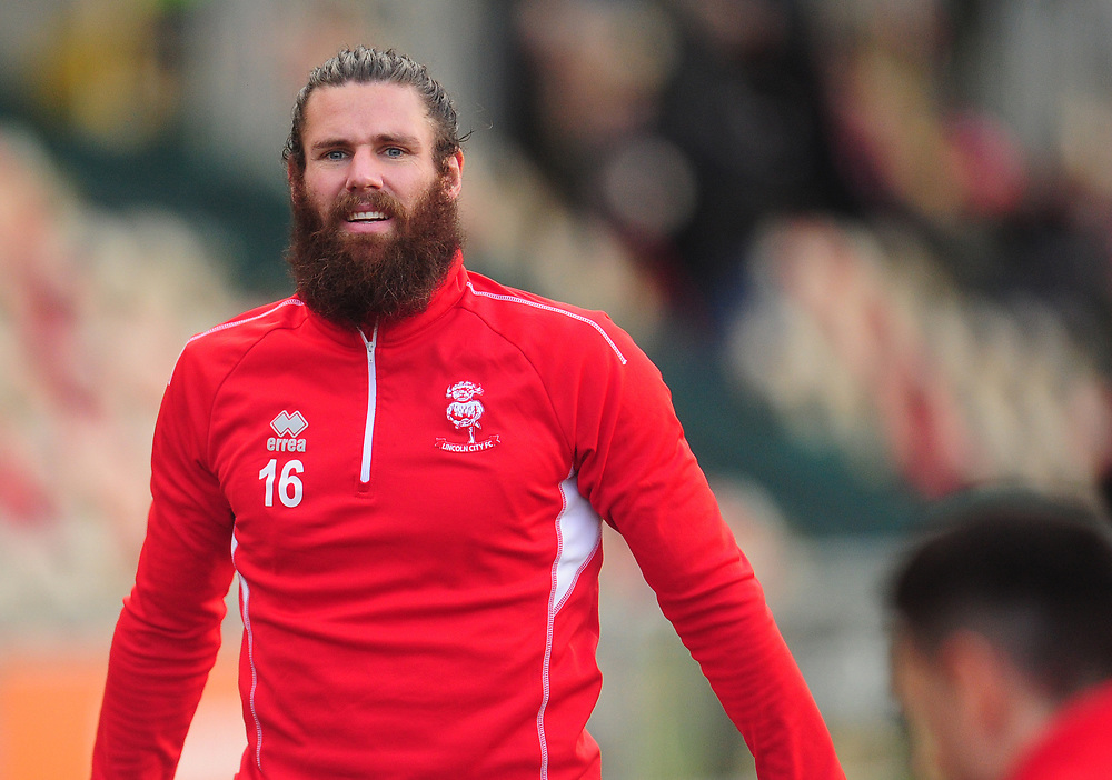 Lincoln City's Michael Bostwick during the pre-match warm-up<br /> <br /> Photographer Kevin Barnes/CameraSport<br /> <br /> The EFL Sky Bet League Two - Newport County v Lincoln City - Saturday 23rd December 2017 - Rodney Parade - Newport<br /> <br /> World Copyright © 2017 CameraSport. All rights reserved. 43 Linden Ave. Countesthorpe. Leicester. England. LE8 5PG - Tel: +44 (0) 116 277 4147 - admin@camerasport.com - www.camerasport.com