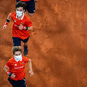 PARIS, FRANCE October 11. Ball boys in action during the Rafael Nadal of Spain match against Novak Djokovic of Serbia in the Singles Final on Court Philippe-Chatrier during the French Open Tennis Tournament at Roland Garros on October 11th 2020 in Paris, France. (Photo by Tim Clayton/Corbis via Getty Images)