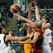 Fenerbahce Ulker's Roko Leni UKIC (R) during their Turkish Basketball league derby match  Fenerbahce Ulker between Galatasaray Cafe Crown at Sinan Erdem Arena in Istanbul, Turkey, Wednesday, April 20, 2011. Photo by TURKPIX