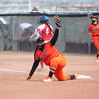 Gallup Bengal first baseman Katelyn Pablo (15) stretches for a catch as the runner Bernalillo Spartan Kiera Touchton (4) is called out Tuesday in Gallup.