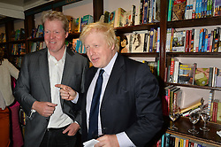 Left to right, EARL SPENCER and BORIS JOHNSON at a party to celebrate the publication of Stanley I Resume by Stanley Johnson at the Daunt Bookshop, Marylebone High Street, London on 23rd September 2014.