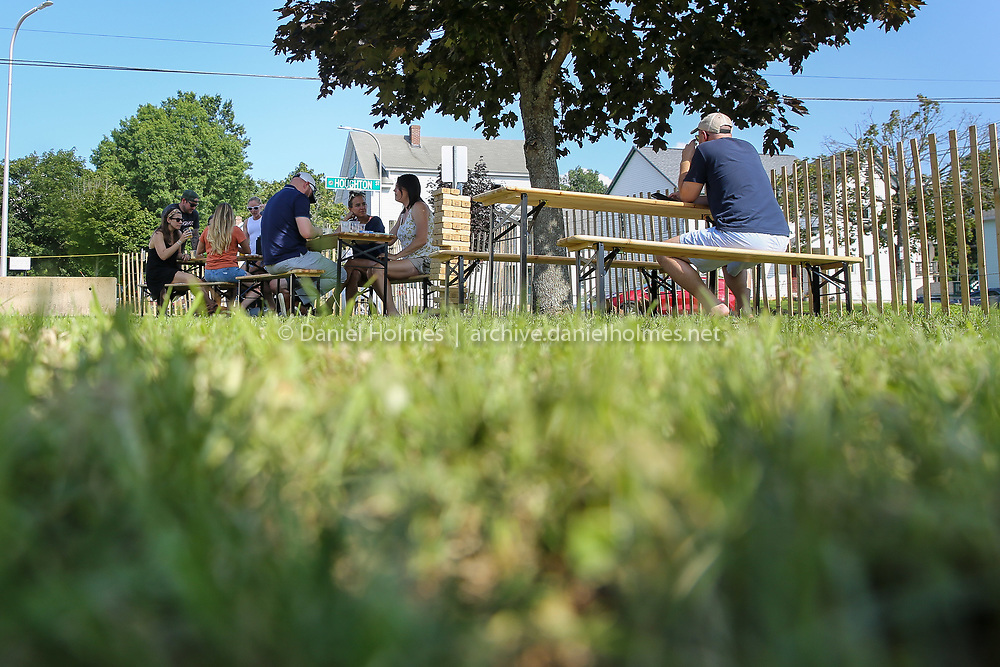 (7/26/19, HUDSON, MA) People enjoy some beers in the shade at the Medusa Brewing Co. Beer Garden in Hudson on Friday. [Daily News and Wicked Local Photo/Dan Holmes]